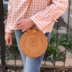 Pink Haley round wicker crossbody